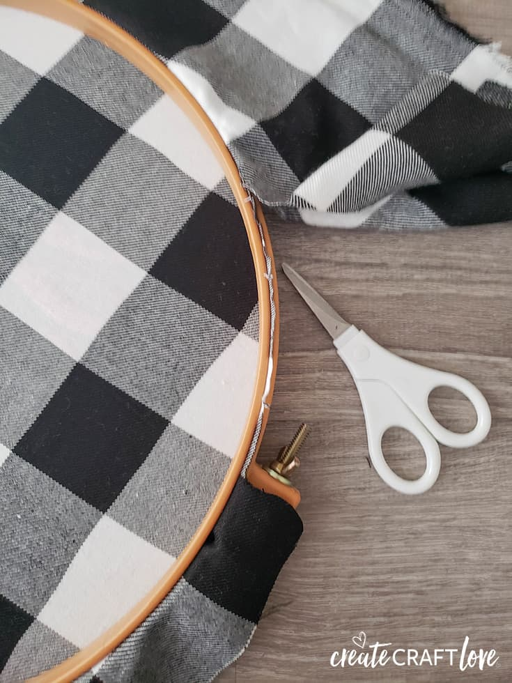 trim excess fabric for embroidery hoop halloween wreath